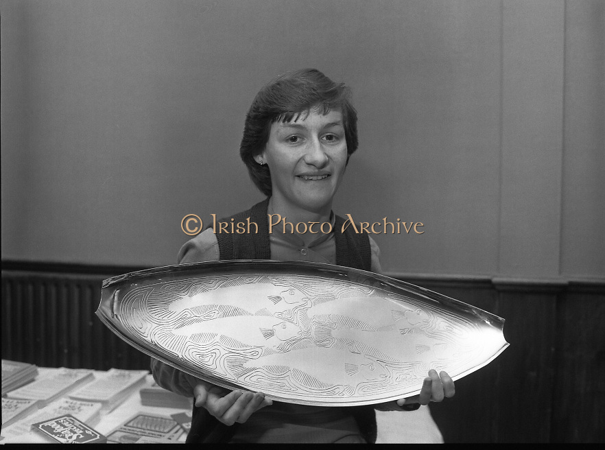 """The National Fish Cookery Award""..29.04.1982..04.29.1982.29th April 1982.1982..This competition sponsored by Bord Iascaigh Mhara was held in The Clare Inn, Newmarket-on Fergus,Co Clare. the competition was open to schools across the country..The Competition winner,Catherine O'Sullivan,(15),Vocational School,Rathdowney,Laois poses with her specially commissioned silver salver."