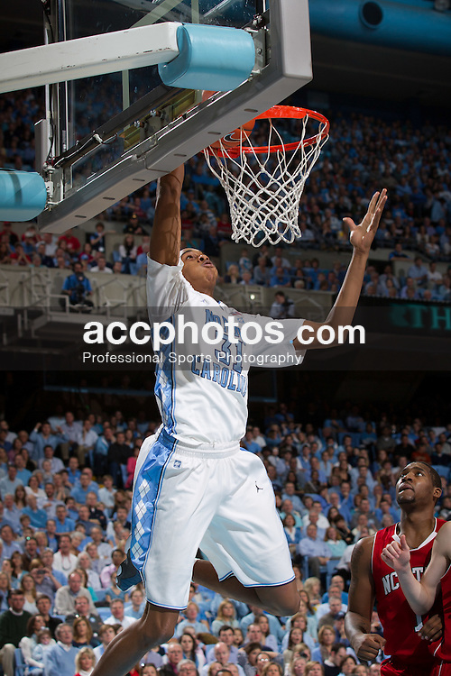 CHAPEL HILL, NC - JANUARY 29: John Henson #31 of the North Carolina Tar Heels scores while playing the North Carolina State Wolfpack on January 29, 2011 at the Dean E. Smith Center in Chapel Hill, North Carolina. North Carolina won 84-64. (Photo by Peyton Williams/UNC/Getty Images)  *** Local Caption *** John Henson