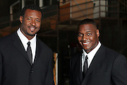 LOS ANGELES - JULY 19:  Linebacker Willie McGinest (left) of the Super Bowl XXXIX Champion New England Patriots, and linebacker Derrick Brooks of the Super Bowl XXXVII Champion Tampa Bay Buccaneers during a break in the filming of the NFL's 2005 Super Bowl XL television ad campaign in Los Angeles, California on July 19, 2005. ©Paul Anthony Spinelli *** Local Caption *** Derrick Brooks, Willie McGinest