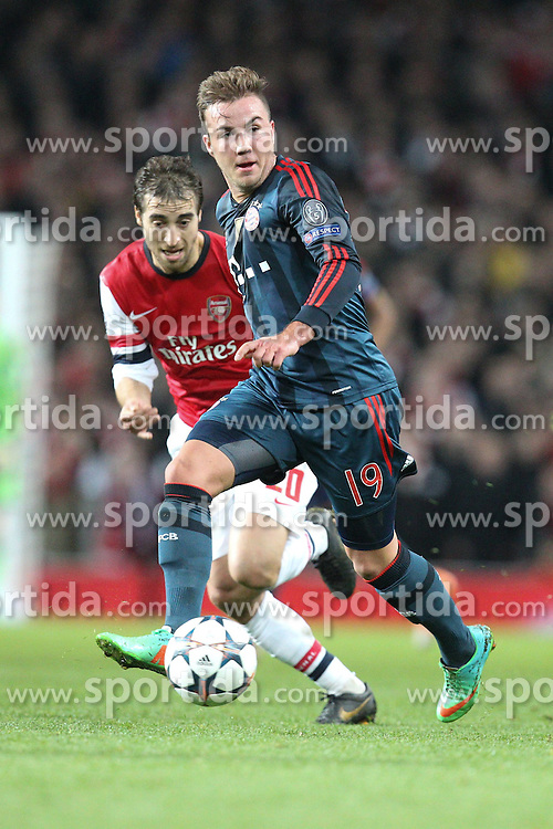 19.02.2014, Emirates Stadion, London, ENG, UEFA CL, FC Arsenal vs FC Bayern Muenchen, Achtelfinale, im Bild l-r: Mathieu Flamini #20 (FC Arsenal London), Mario GOETZE #19 (FC Bayern Muenchen) // during the UEFA Champions League Round of 16 match between FC Arsenal and FC Bayern Munich at the Emirates Stadion in London, Great Britain on 2014/02/19. EXPA Pictures © 2014, PhotoCredit: EXPA/ Eibner-Pressefoto/ Kolbert<br /> <br /> *****ATTENTION - OUT of GER*****
