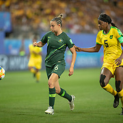 GRENOBLE, FRANCE June 18.  Chloe Logarzo #6 of Australia defined by Konya Plummer #5 of Jamaica during the Jamaica V Australia, Group C match at the FIFA Women's World Cup at Stade des Alpes on June 18th 2019 in Grenoble, France. (Photo by Tim Clayton/Corbis via Getty Images)