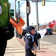 03/26/2011, Lawrence. George Iker Richardson, 18 meses, sostiene un flyer de la campaña en favor del 4% para educacion.<br /> <br /> Desafiando temperaturas de 13F y bajo una fuerte brisa, George Iker y sus padres, distribuyen flyer en las calles de Lawrence, MA.<br /> <br /> La campaña civica fue organizada por la organizacion Somos Patria. <br /> <br /> Foto: George Richardson