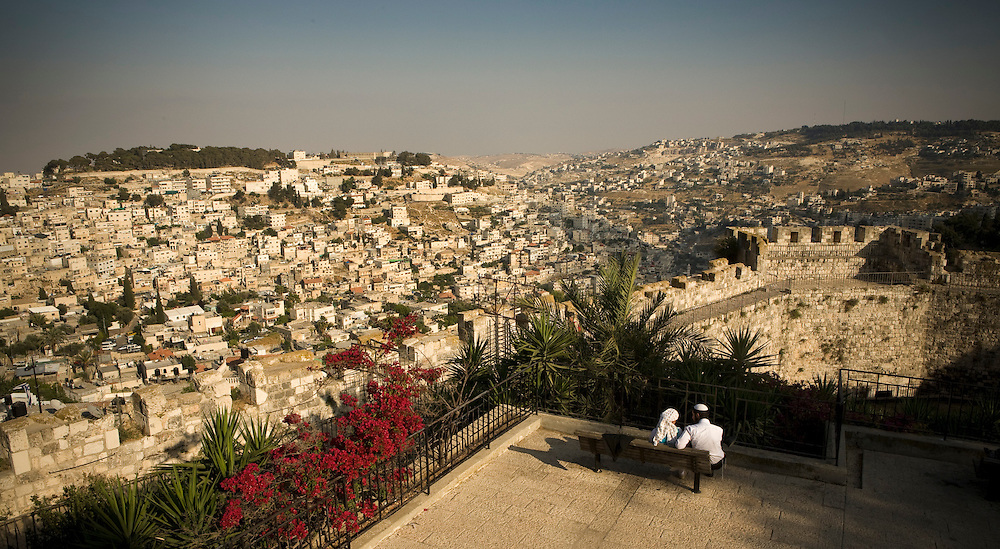A couple sit overlooking Jerusalem on Saturday 17th May 2008