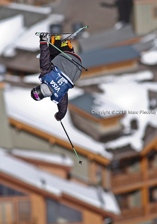 SHOT 12/19/13 1:06:54 PM - French skier Xavier Bertoni gets inverted while competing in the Men's Ski Halfpipe Qualifiers at the U.S. Snowboarding and Freeskiing Grand Prix on December 19, 2013 at Copper Mountain, Colorado.<br /> (Photo by Marc Piscotty / &copy; 2013)
