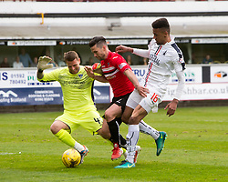 Dunfermline's keeper David Hutton, Dunfermline's Jason Talbot and Falkirk's Nathan Austin. Dunfermline 1 v 2 Falkirk, Scottish Championship game played 22/4/2017 at Dunfermline's home ground, East End Park.