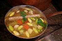 preparation of a hotdog Tete de Veau   -..cooked in a bouilion de volaiile..- photograph by Owen Franken..February 9, 2012..