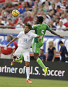 JACKSONVILLE, FL - JUNE 07:  Forward Chris Wondolowski #18 of the United States goes up for a head ball against defender Eric Efe Ambrose #5 of Nigeria during the international friendly match at EverBank Field on June 7, 2014 in Jacksonville, Florida.  (Photo by Mike Zarrilli/Getty Images)