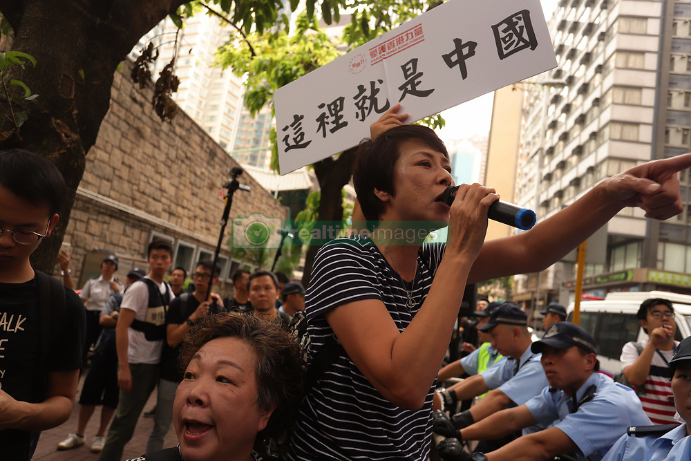 October 1, 2018 - Hong Kong, CHINA - Pro-China demonstrators throw abuses at the Hong Kong independence supporters at the 10.1 rally, the banner reads : THIS PLACE IS INDEED CHINA. Today marks the 69th anniversary of the founding of PRC. Oct-1,2018 Hong Kong.ZUMA/Liau Chung-ren (Credit Image: © Liau Chung-ren/ZUMA Wire)