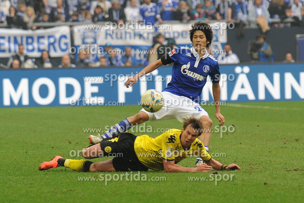 14.04.2012, Veltins Arena, Gelsenkirchen, GER, Schalke 04 vs Borussia Dortmund, 31. Spieltag, im Bild Atsuto Uchida ( oben Schalke 04 ) wird von Kevin Grosskreutz ( unten Borussia Dortmund/ Action/ Aktion ) umgegraetscht. // during the German Bundesliga Match, 31th Round between Schalke 04 and Borussia Dortmund at the Veltins Arena, Gelsenkirchen, Germany on 2012/04/14. EXPA Pictures © 2012, PhotoCredit: EXPA/ Eibner/ Thomas Thienel..***** ATTENTION - OUT OF GER *****