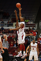 Nov 28, 2011; Stanford CA, USA;  Stanford Cardinal forward/center Josh Owens (13) wins the opening tipoff from Pacific Tigers center Rundell Mauge (back) during the first half at Maples Pavilion.  Mandatory Credit: Jason O. Watson-US PRESSWIRE