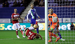 Wigan Athletic's Nick Powell (centre) scores his side's first goal of the game during the Sky Bet Championship match at the DW Stadium, Wigan.