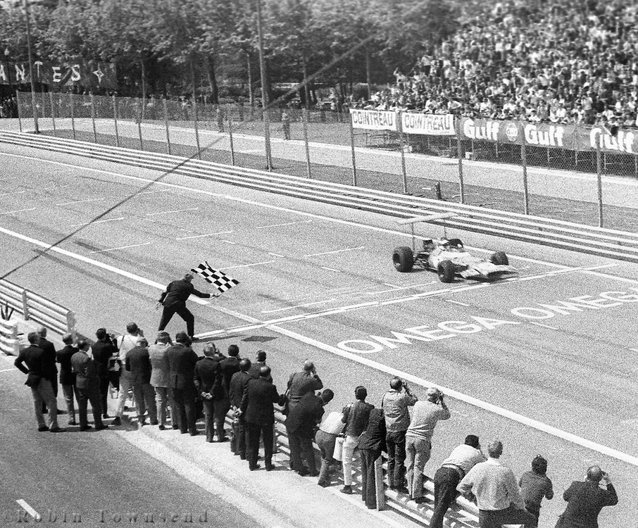 British driver, Jackie Stewart, crosses the finish line first place during the 1969 Spanish Grand Prix at the Montjuïc urban circuit in Barcelona, Spain.