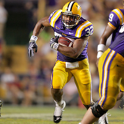 19 September 2009: LSU Tigers running back Charles Scott (32) runs with the ball during a 31-3 win by the LSU Tigers over the University of Louisiana-Lafayette Ragin Cajuns at Tiger Stadium in Baton Rouge, Louisiana.