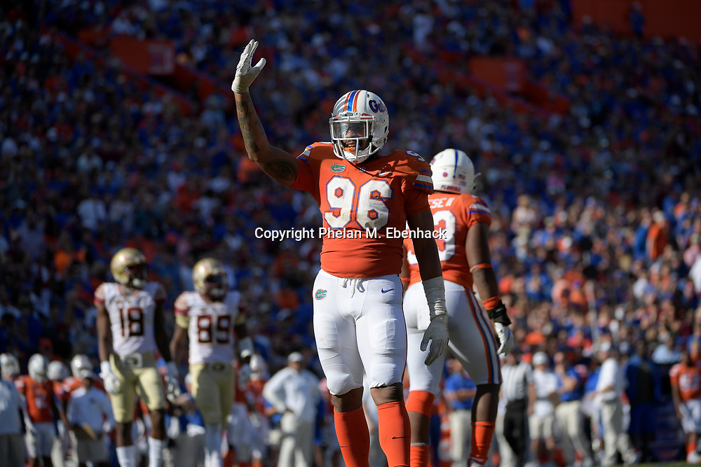 Florida defensive lineman Cece Jefferson (96) encourages the crowd during the second half of an NCAA college football game against Florida State Saturday, Nov. 25, 2017, in Gainesville, Fla. FSU won 38-22. (Photo by Phelan M. Ebenhack)