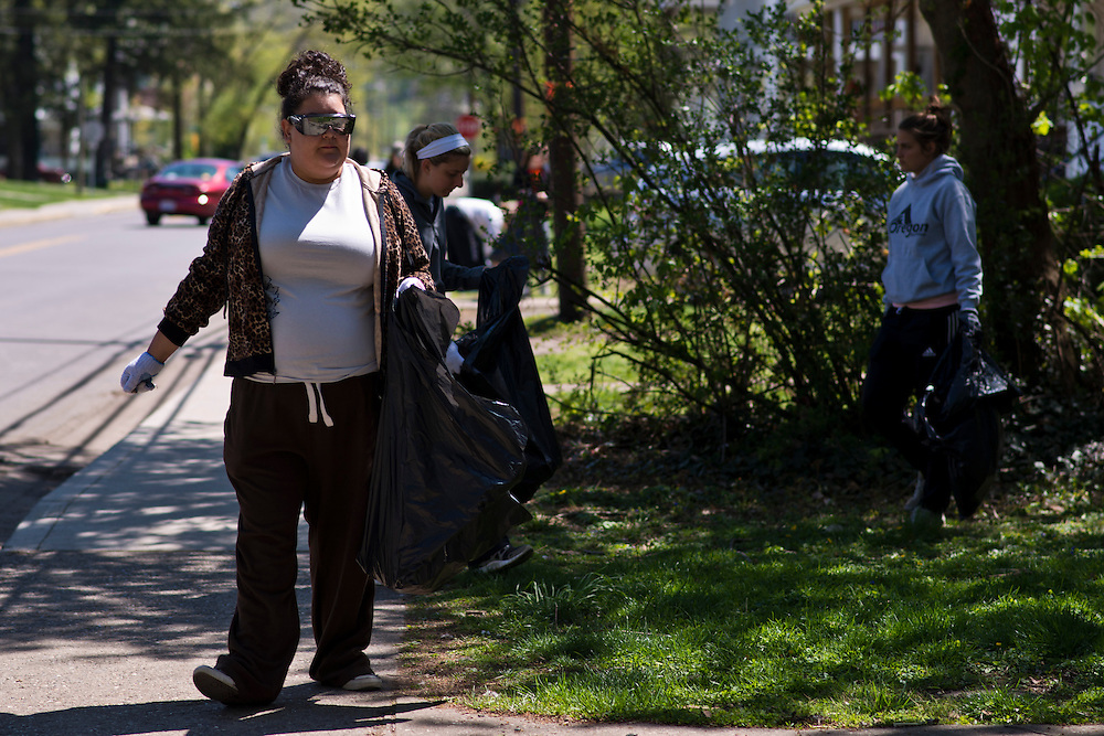 Tiffani Smith, left, walks down Mill Street looking for trash to pick up during the Off Campus Living Fest Clean Up event Sunday, April 21, 2013. Students picked up trash long the sidewalks and grass to prevent trash build up after fest season came to a close for the school year with Palmer Fest, which was held the previous Saturday, April 20.