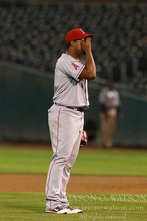 September 13, 2011; Oakland, CA, USA;  Los Angeles Angels starting pitcher Jerome Williams (57) reacts after walking home a run against the Oakland Athletics during the third inning at O.co Coliseum.