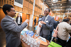 "18 September 2017, Geneva, Switzerland: A ""marketplace"" at the Ecumenical Centre in Geneva presents resources and activities of the World Council of Churches, at it hosts a meeting of member churches' Ecumenical Officers. Here, Dinesh Suna showcasing a World Council of Churches Blue Community water bottle."