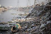 Trash piled up on the banks of the river between Kamrangirchar and Dhaka.