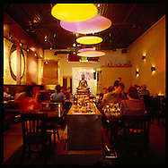Downtown Boise is home to 85 restaurants, including Mai Thai, popular for its spicy lunch dishes.  Pictured here is the main dining room complete with lotus flowers, Asian decor and modern lighting.