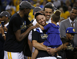 June 12, 2017 - Oakland, California, U.S. - The Golden State Warriors' KEVIN DURANT, left, and STEPHEN CURRY share a laugh after defeating the Cleveland Cavaliers, 129-120, in Game 5 of the NBA Finals at Oracle Arena. (Credit Image: © Nhat V. Meyer/TNS via ZUMA Wire)