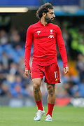 Liverpool forward Mohamed Salah (11) warms up before the Premier League match between Chelsea and Liverpool at Stamford Bridge, London, England on 22 September 2019.