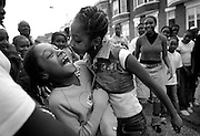 Krystal Gardner, 13, dances into 8-year-old Jasmine Hardy's space during a Harlem Street block party in Baltimore. The dance off competitions went on without altercation, though a few egos may have been bruised.
