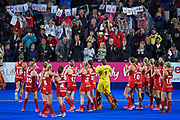The England Hockey team applaud the  England  1975 World Cup Winners team sat in the crowd with their banner during the Vitality Hockey Women's World Cup 2018 Pool B match between England and Ireland at the Lee Valley Hockey and Tennis Centre, QE Olympic Park, United Kingdom on 29 July 2018. Picture by Martin Cole.