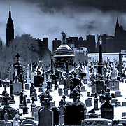 The first Calvary Cemetery in Queens, New York covered in snow with Manhattan cityscape view.
