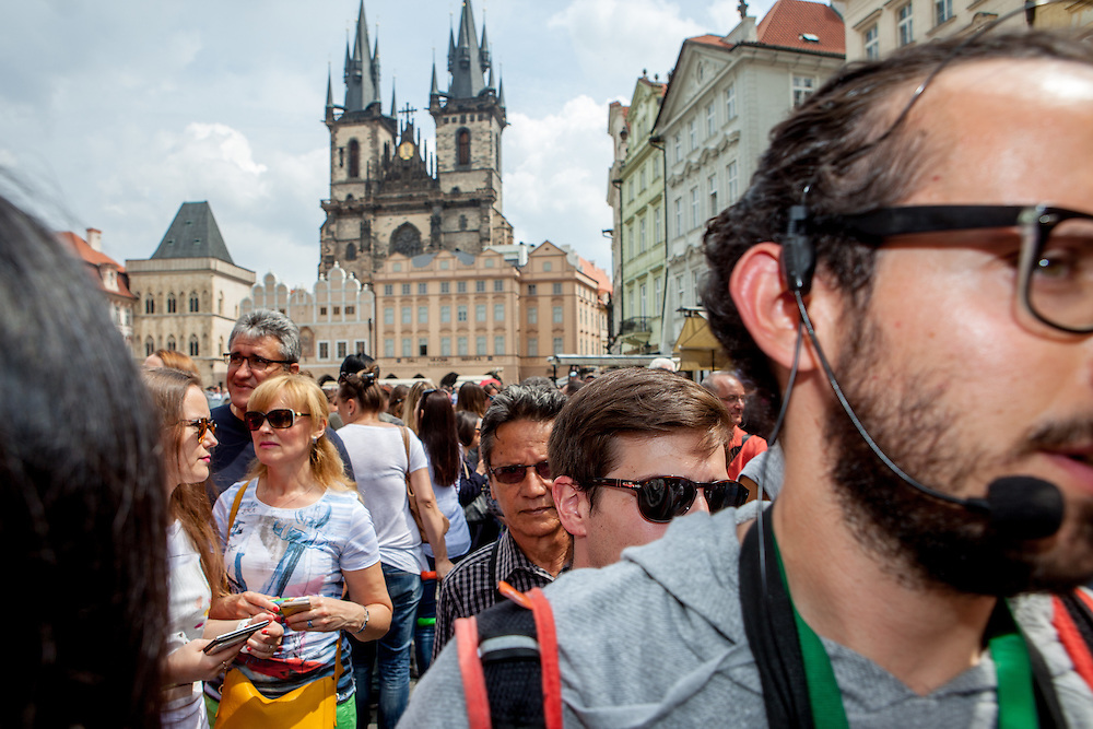 A tourist guide with his group at Old Town Square in Prague. One of the main attractions on the square is The Prague astronomical clock, or Prague orloj (Czech: Pražský orloj) which is a medieval astronomical clock. The clock was first installed in 1410, making it the third-oldest astronomical clock in the world and the oldest one still operating.