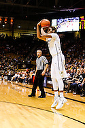 December 28th, 2013:  Colorado Buffaloes sophomore forward Xavier Johnson (2) pulls up for a three point shot in the second half of action in the NCAA Basketball game between the Georgia Bulldogs and the University of Colorado Buffaloes at the Coors Events Center in Boulder, Colorado