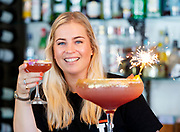 Mixologist Sophie from LP in Bury St Edmunds makes a EuroMillions MultiMillionaire cocktail ahead of Friday 21st September's £110M guaranteed EuroMillions draw.