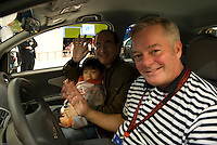 Petri Saraste at the Shanghai autoshow 2009 in a Chery car with a chinse visitor and his son.