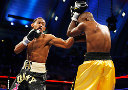 October 18, 2008; Atlantic City, NJ, USA;  Daniel Jacobs  (black trunks) and Tyrone Watson (yellow trunks) trade punches during their 6 round super middleweight fight at Boardwalk Hall in Atlantic City, NJ.  Jacobs won the fight via 1st round KO.