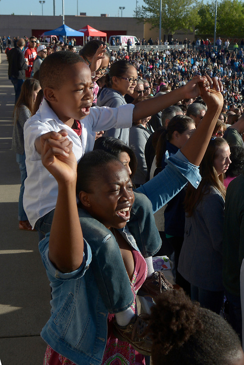 gbs041617a/ASEC --Betty Baazing-yeng and her son Sheldon, 5, of Albuquerque clap hands and dance during a song at the Calvary Albuquerque Easter Sunrise Service in University Stadium on Sunday, April 16, 2017. (Greg Sorber/Albuquerque Journal)