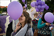 Woman with Purple Balloons