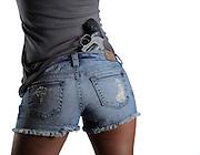 Girl with handgun in back pocket