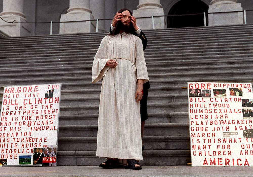WASHINGTON---- Public school prayer activist Rita Warren fixes her Jesus' figure's hair on the steps of the Capitol's East front.  Ms. Warren was forced to move her display to make room for a GOP press conference on tax relief.