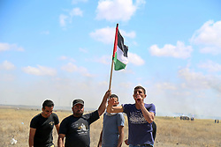 May 19, 2017 - Clashes have broken out between Israeli Forces and protesters in the Gaza strip, near the border with Israel, during a demonstration in solidarity with Palestinian prisoners on hunger strike in Israeli jails. During the protest the Israeli forces opened fire and used tear gas and stun grenades in order to disperse the demonstrators, who in return threw stones at them. Ashraf al-Qudra, a spokesman for the Gaza's ministry of health has said that nine demonstrators were injured from the Israeli live fire while more than thirty were wounded as a result of the tear gas during the clashes in the Gaza Strip (Credit Image: © Samar Abu Elouf/ImagesLive via ZUMA Wire)