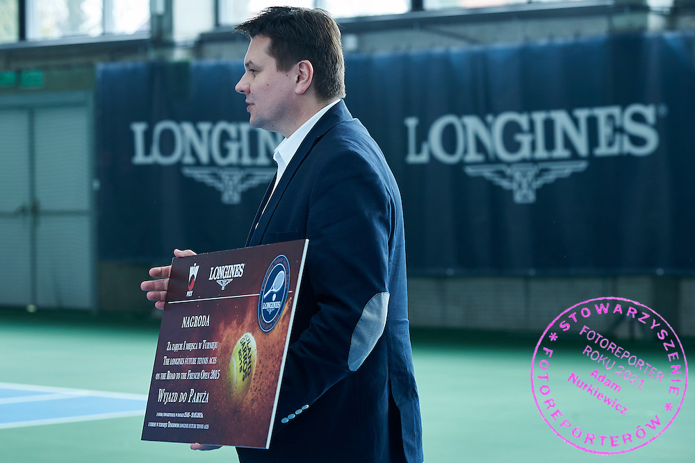Leszek Pilch from Longines watch while victory ceremony during the Longines Future Tennis Aces 2015 at Tuan Tennis Club in Jozefoslaw near Warsaw on April 11, 2015.<br /> <br /> Poland, Warsaw, April 11, 2015<br /> <br /> Picture also available in RAW (NEF) or TIFF format on special request.<br /> <br /> For editorial use only. Any commercial or promotional use requires permission.<br /> <br /> Mandatory credit:<br /> Photo by &copy; Adam Nurkiewicz / Mediasport
