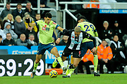 Joelinton (#9) of Newcastle United is fouled by Dominic Solanke (#9) of AFC Bournemouth and Philip Billing (#29) of AFC Bournemouth during the Premier League match between Newcastle United and Bournemouth at St. James's Park, Newcastle, England on 9 November 2019.