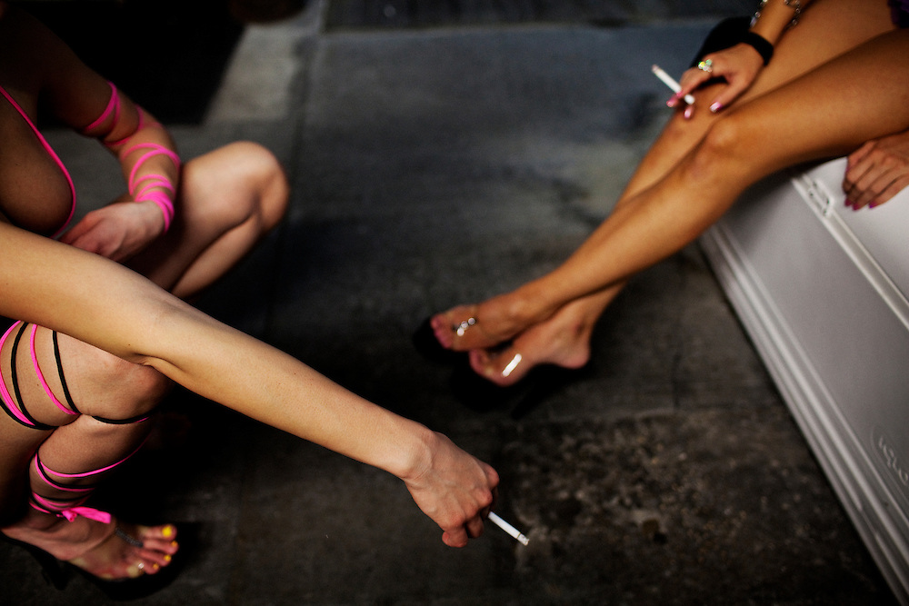 Dancers take a smoke break at the world famous Mons Venus strip club in Tampa, Florida on Sunday, May 24, 2009.