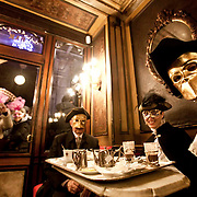 "Masked revellers have a coffee break at ""Florian Café"" in Saint Mark Square during the first day of Venetian Carnival in Venice."