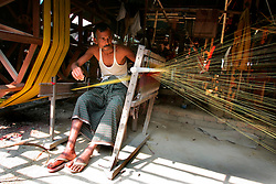BANGLADESH SIRAJGANJ RADHUNIBARI 30JAN07 - Weavers rig a big drum with different colours of yarn, to be used to create yardage on handlooms. Records of an indigenous weaving industry based on handlooms producing cotton fabrics date back to the 13th century in this area...jre/Photo by Jiri Rezac..© Jiri Rezac 2007..Contact: +44 (0) 7050 110 417.Mobile:  +44 (0) 7801 337 683.Office:  +44 (0) 20 8968 9635..Email:   jiri@jirirezac.com.Web:    www.jirirezac.com..© All images Jiri Rezac 2007 - All rights reserved.