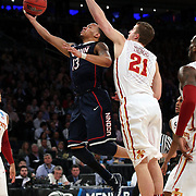 Shabazz Napier, Connecticut, drives to the basket while challenged by Matt Thomas, Iowa, during the Iowa State Cyclones Vs Connecticut Huskies basketball game during the 2014 NCAA Division 1 Men's Basketball Championship, East Regional at Madison Square Garden, New York, USA. 28th March 2014. Photo Tim Clayton
