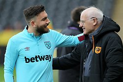 West Ham United's Robert Snodgrass (left) speaks with Hull City kit logistics manager Frank Donoghue before the game