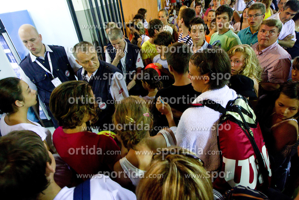 Fans outside the court wait for Jelena Jankovic of Serbia when she retired with an injury of her left ankle in her match  against Anastasiya Yakimova of Belarus  at 2nd Round of Singles at Banka Koper Slovenia Open WTA Tour tennis tournament, on July 22, 2010 in Portoroz / Portorose, Slovenia. At photo Andreja Klepac of Slovenia when she wants to go in her wardrobe. (Photo by Vid Ponikvar / Sportida)