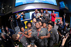 "The Michigan Wolverines celebrate winning the  ""Battle for Bowl Week"" belt against the Florida Gators at the College Football Hall of Fame on Wednesday, December 26, 2018, in Atlanta. Michigan will face Florida in the 2018 Chick-fil-A Peach Bowl NCAA football game on December 29, 2018. (Paul Abell via Abell Images for the Chick-fil-A Peach Bowl)"