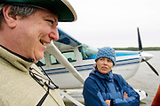 Nahanni River, NWT: August 25, 2006 -- NAHANNI RIVER CANOE TRIP 2006 --  Don Land (L) tells tall tales to a disbelieving Flavia Ferrero as the float plane waits in Fort Simpson prior to a canoe trip down the Nahanni River in the Northwest Territories August 25...Steve McKinley photo.