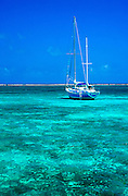 Sailboat and tropical ocean water, Ambergris Caye, Belize