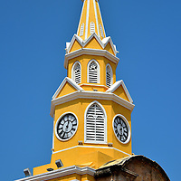Torre del Reloj in Old Town, Cartagena, Colombia<br /> The Bridge Gate was constructed in 1631 as Cartagena de Indias became a walled-in city. This main entrance has been damaged, restored and changed several times. Today's version of this beautiful Gothic clock tower - designed by Luis Felipe Jaspe Franco - was finished in 1888. The 98.5 foot Torre del Reloj is a symbolic landmark of Cartagena. It is located near the head of Bahía Las Ánimas. Walk beneath its arched portal and you enter Old Town's Plaza de los Coches.